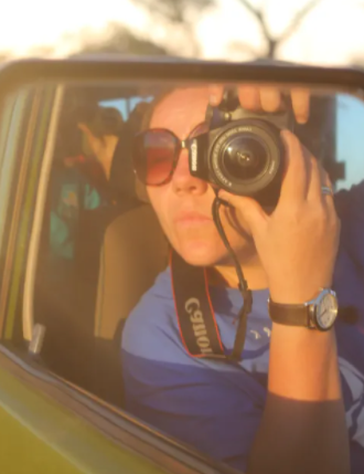Wing-mirror selfie in a safari car in the Serengeti National Park, Tanzania